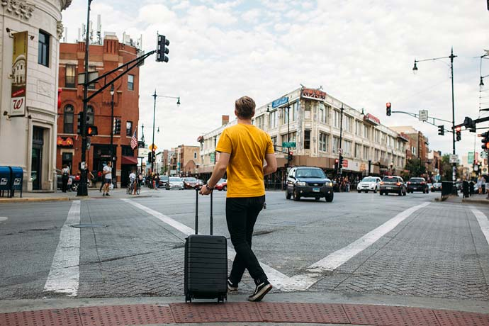 man with suitcase in city