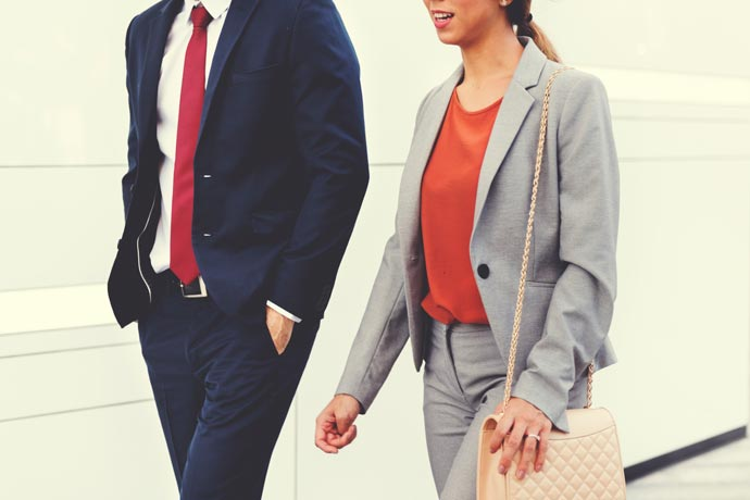 two business people walking