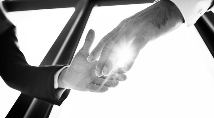 backlit business handshake