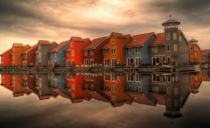 rows of colourful houses alongside body of water