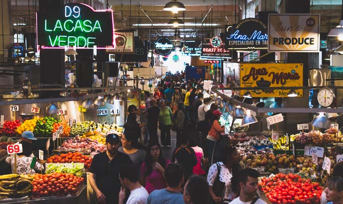 image of busy marketplace with multiple stalls
