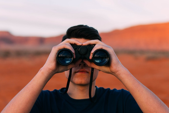 person using binoculars