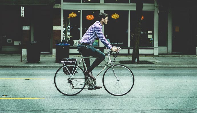 employee commuting on bike
