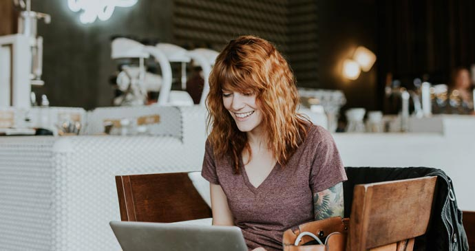woman working remotely smiling at screen