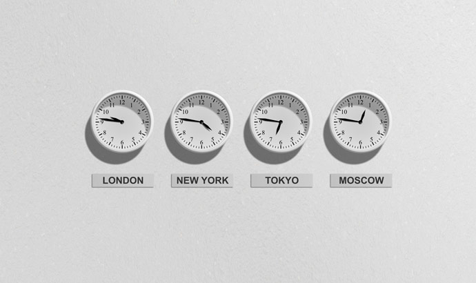 clocks in four different time zones