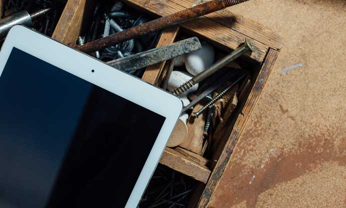 tablet and rusty tools